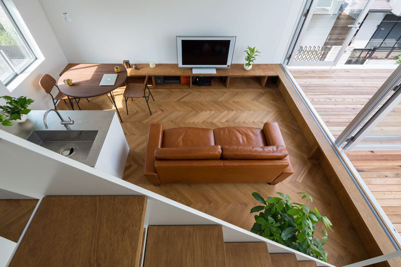 Interior Design Ideas - 17 Modern Living Rooms As Seen From Above | Various shades of brown give this living space a more natural feel that's accentuated by the plants and wood elements.