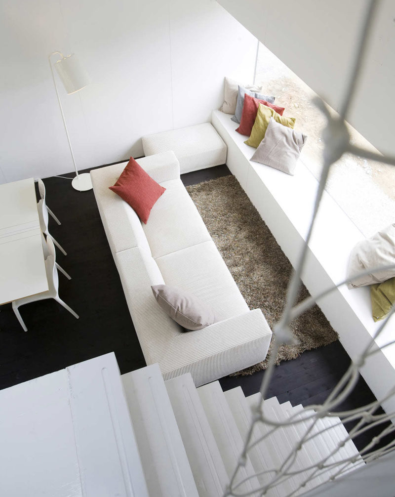 Interior Design Ideas - 17 Modern Living Rooms As Seen From Above   Colorful pillows inject a bit of life into this clean white living space that also features dark wood flooring.
