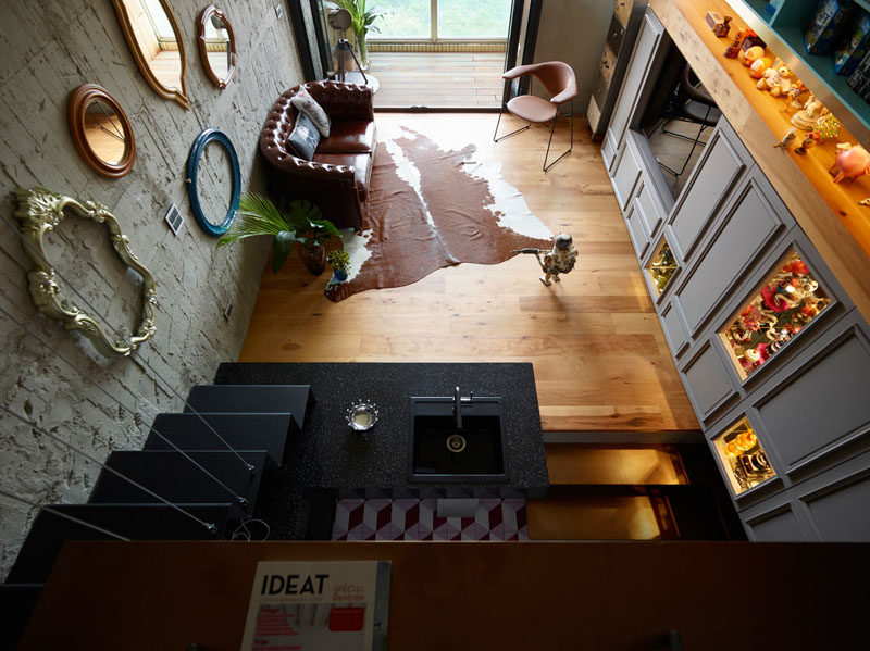 Interior Design Ideas - 17 Modern Living Rooms As Seen From Above   The kitchen and living room of this small apartment are connected to each other thanks to the open concept design making it easy to cook and entertain at the same time.