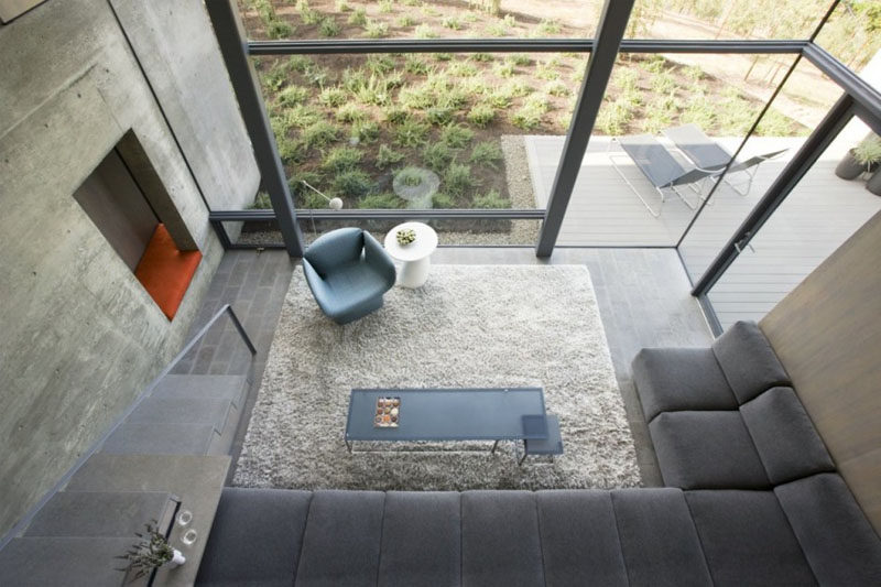 Interior Design Ideas - 17 Modern Living Rooms As Seen From Above   Walls of windows keep this neutral living room bright and inviting.