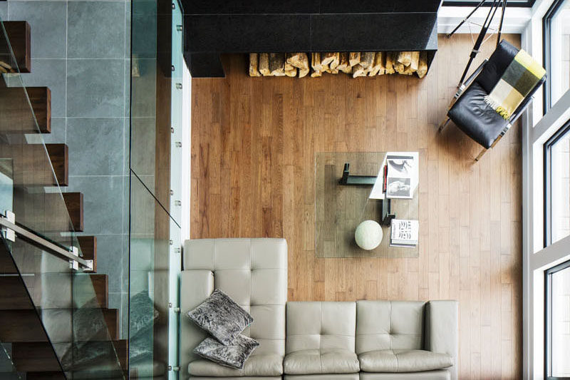 Interior Design Ideas - 17 Modern Living Rooms As Seen From Above   The glass coffee table, small sofa, and large windows help this small space feel larger and more open that it actually is.