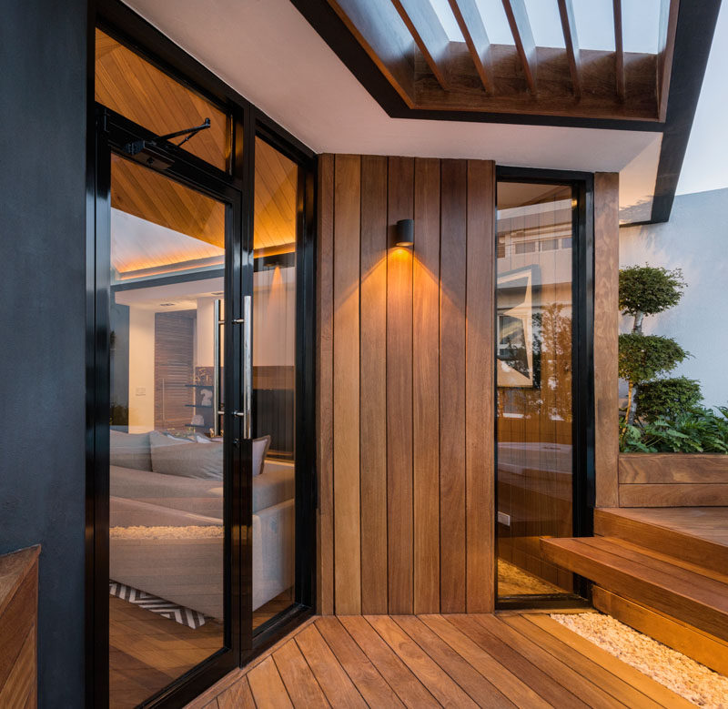 This rooftop terrace has wood siding that flows down to the deck of the outdoor area.