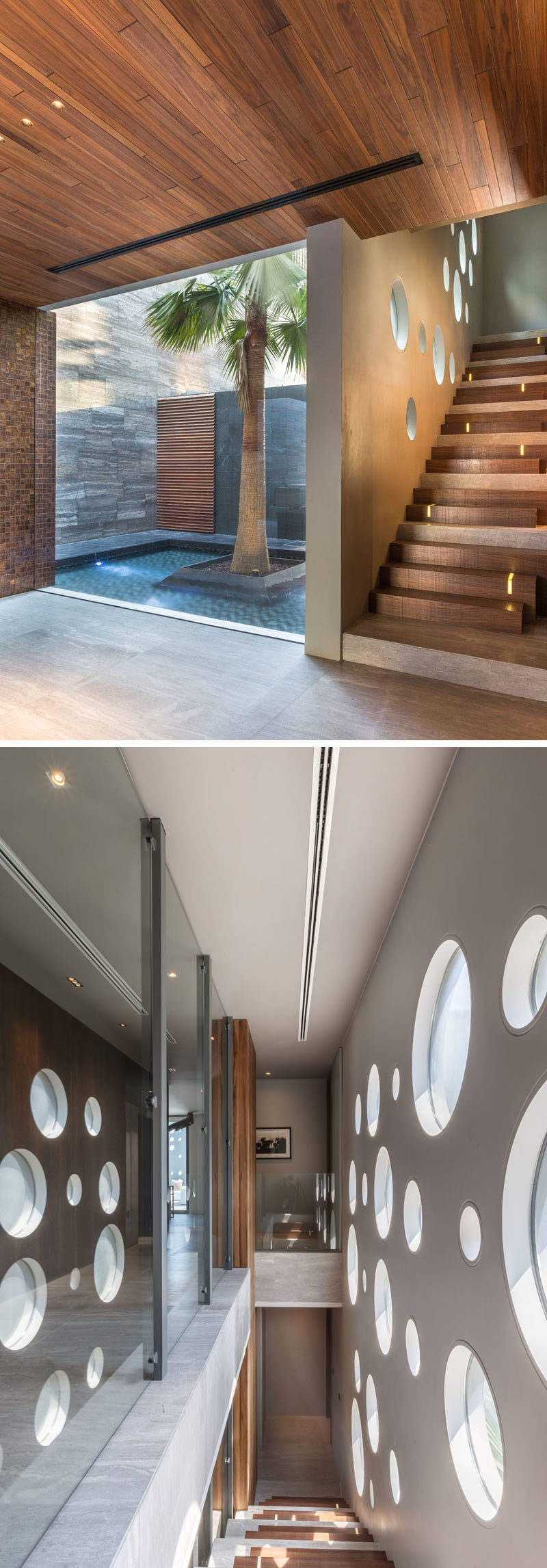 Large circular windows in the walls provide natural sunlight to the staircase.