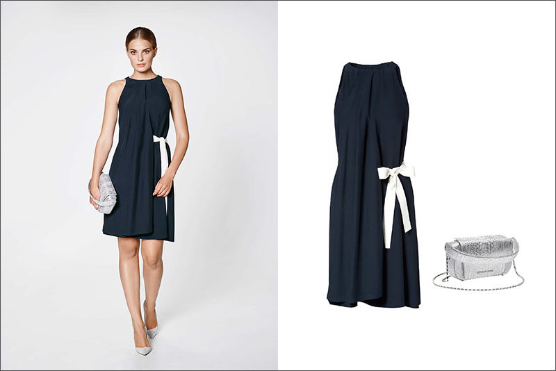 Women's Fashion Ideas - 12 Women's Outfits From Porsche Design's 2017 Spring/Summer Collection // A navy dress with a white side bow and a silver bag create this girly women's outfit.