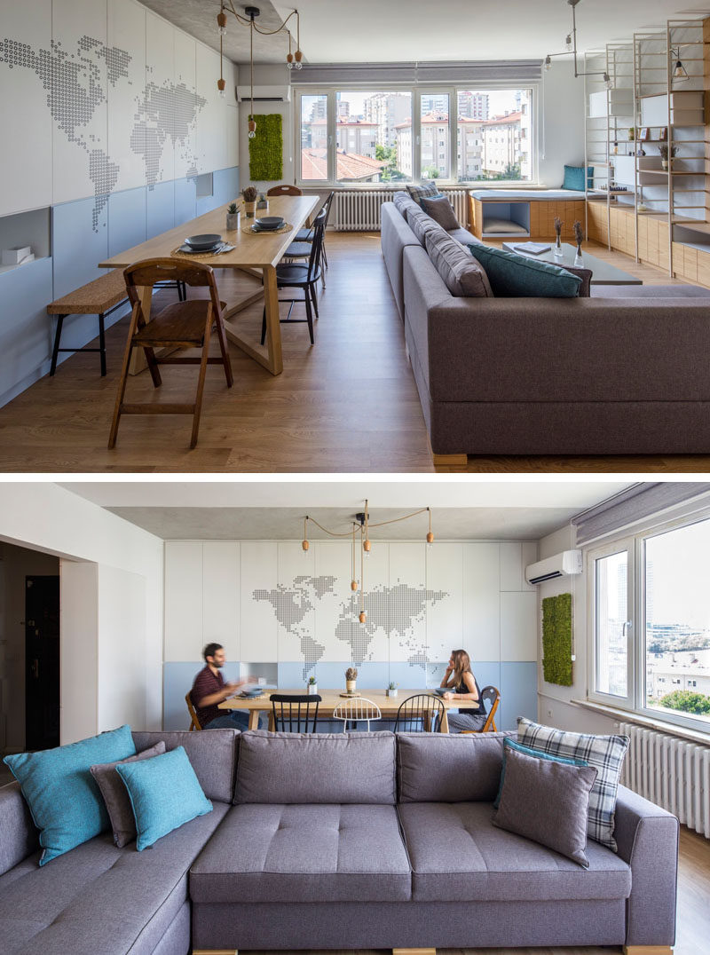 In this contemporary apartment, the living room and dining room both share the same space. A small section in front of the window has been made into a window seat that enjoys views of the city.