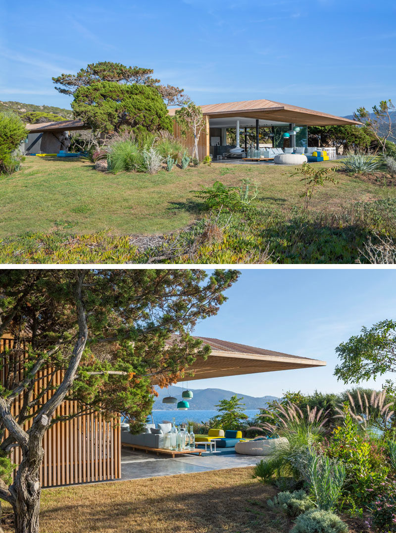 At one end of this villa, there's an outdoor living room receives shade from the extended roof.