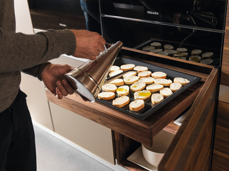 Kitchen Design Idea - Pull-Out Counters (10 Pictures) // A pull out counter installed right under the oven creates a convenient spot to do final prep before putting food into the oven.
