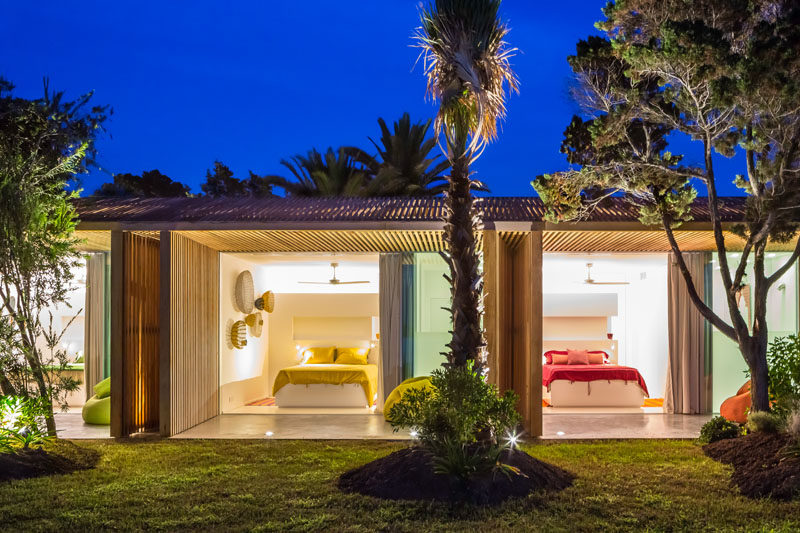 This modern villa has side-by-side bedrooms decorated with specific colors.