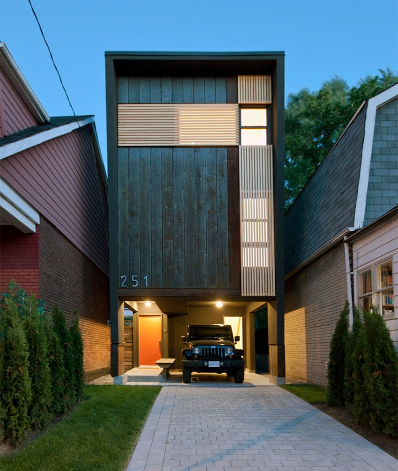 This narrow house fits tightly between the two houses on either side of it and makes up for it's narrow width by being slightly taller than the other houses around it.