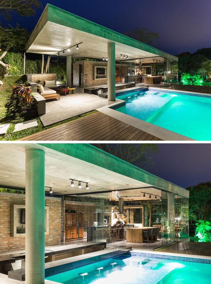 This tropical pool house has a swim up bar and a glass for Pool design with swim up bar