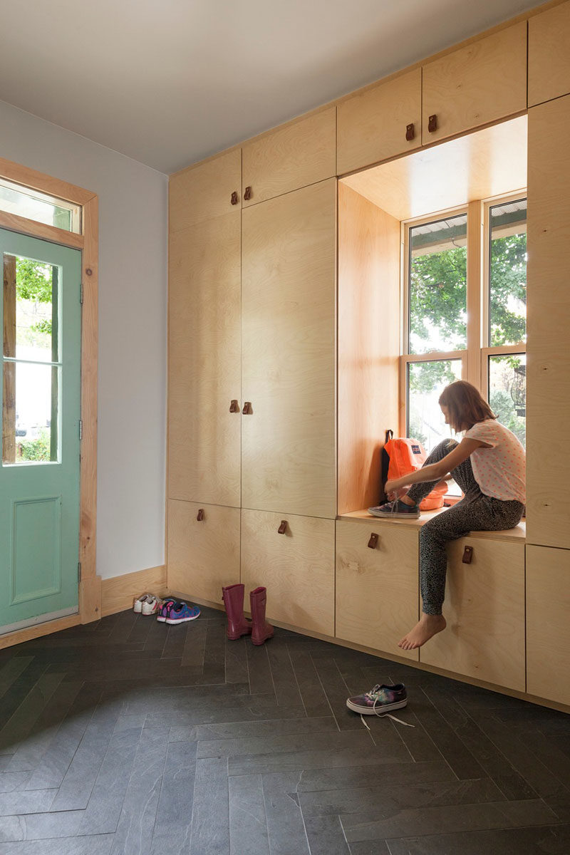 Entryway Design Ideas - A Window Bench Seat Surrounded By A Wall Of Storage