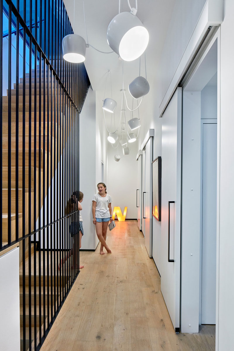 These three kids bedrooms are each accessed by identical sliding doors. Hanging fun white lights make sure the hallway is bright.