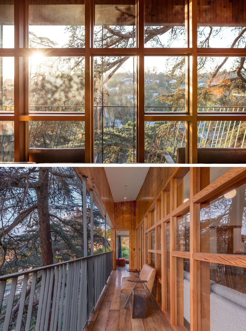 Wood framed windows provide plenty of sunlight and views to the living space. Outside there's a narrow balcony for enjoying the view.