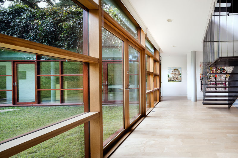 On the lower level of this home, wood frames surround the windows and doors.