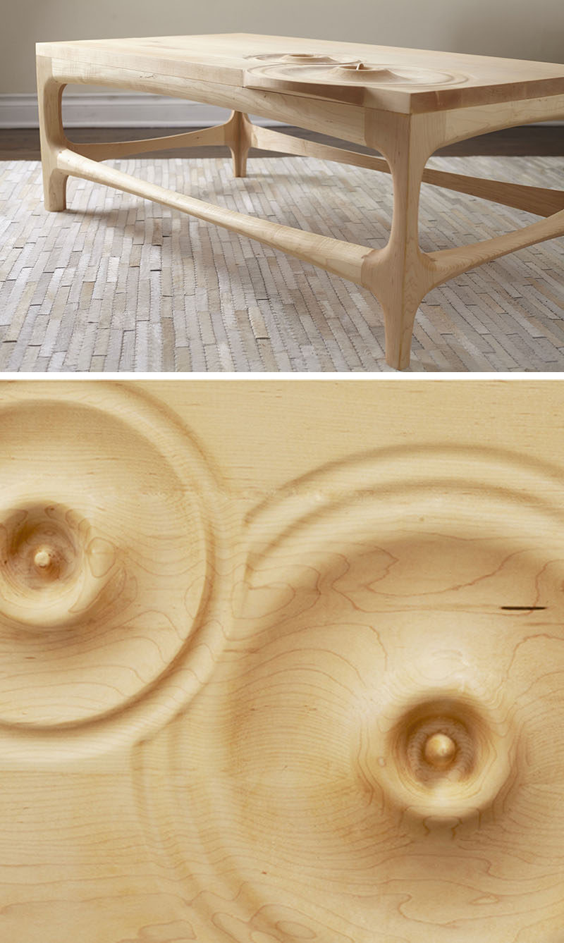 This wooden coffee table features carved sections that look like water droplets.