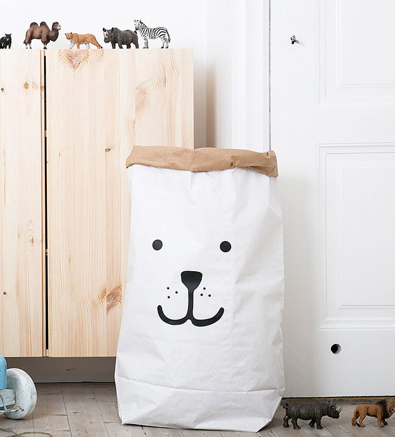 15 Decor Ideas For Creating A Woodland Nursery Design // Toys, blankets, books, dirty clothes, and other things can get overwhelming fast. A large paper bag with a friendly animal face on it can help keep things under control. #WoodlandNursery #BabyNursery #NurseryArt #ModernNursery