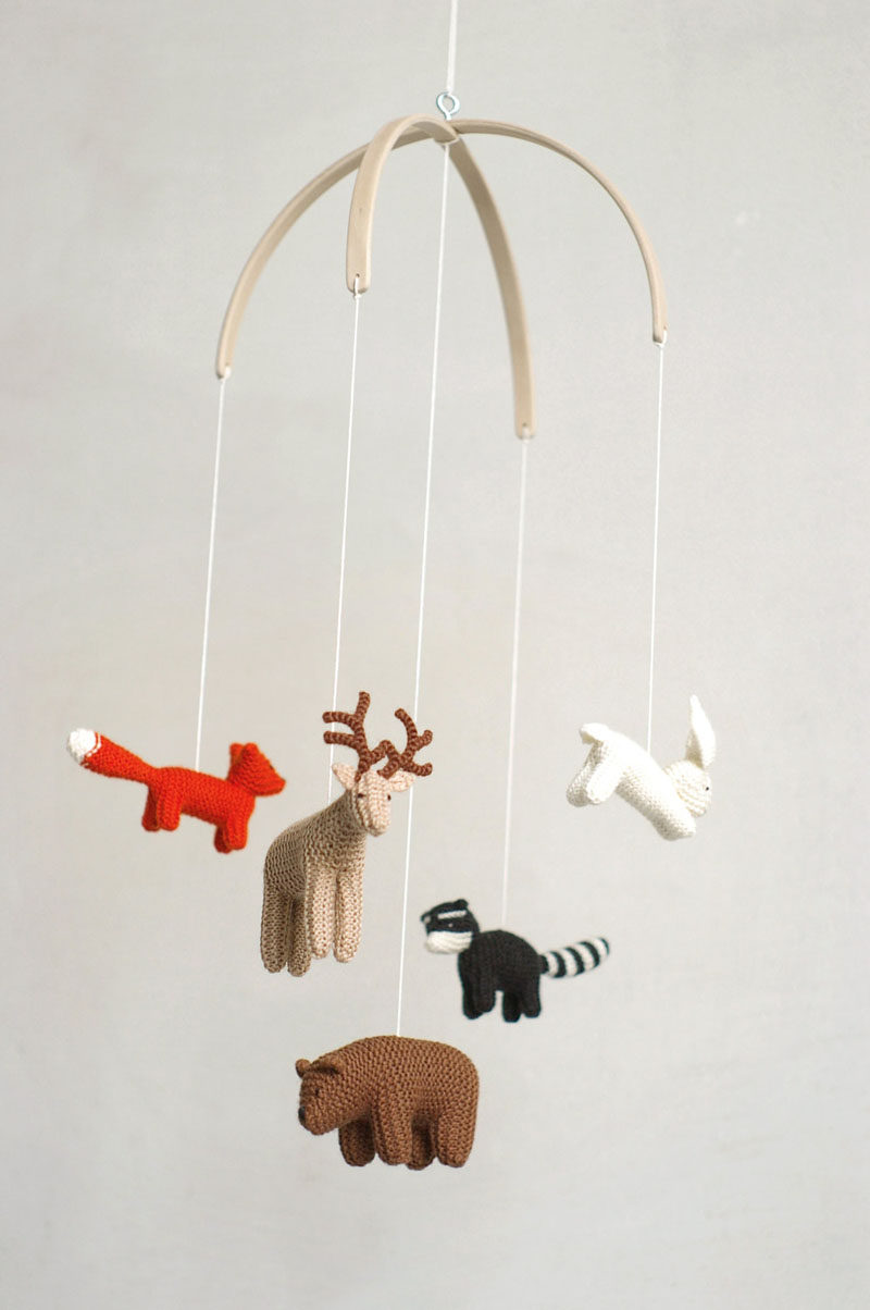15 Decor Ideas For Creating A Woodland Nursery Design // A mobile made from tiny knit animals will keep your baby entertained and tie in with the rest of the woodland pieces you've included in the nursery. #WoodlandNursery #BabyNursery #NurseryArt #ModernNursery