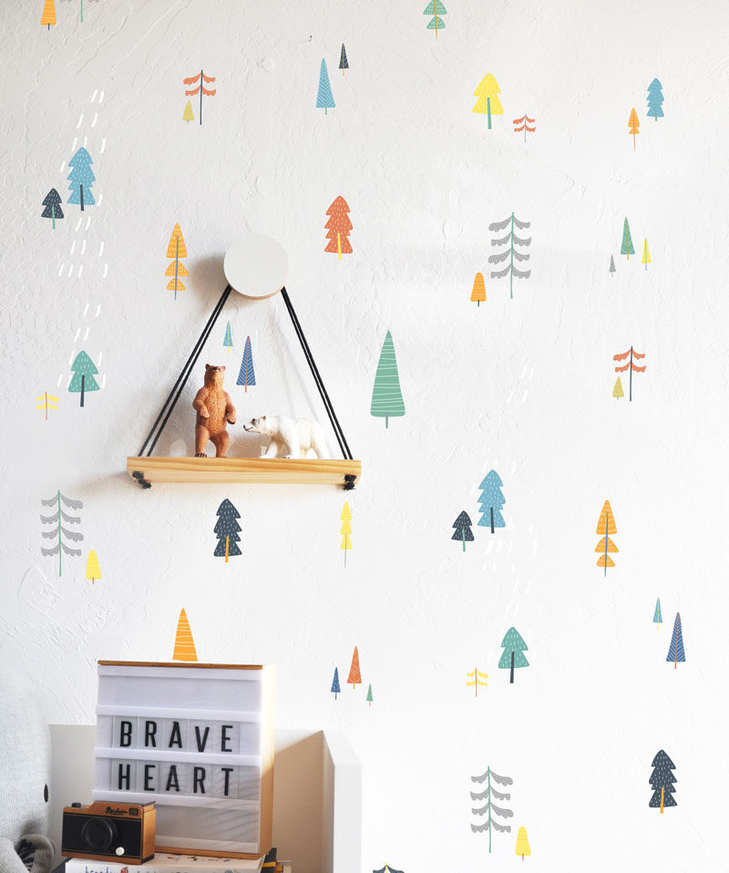 15 Decor Ideas For Creating A Woodland Nursery Design // Small colorful tree wall decals create a more subtle but equally as adorable woodland setting. #WoodlandNursery #BabyNursery #NurseryArt #ModernNursery