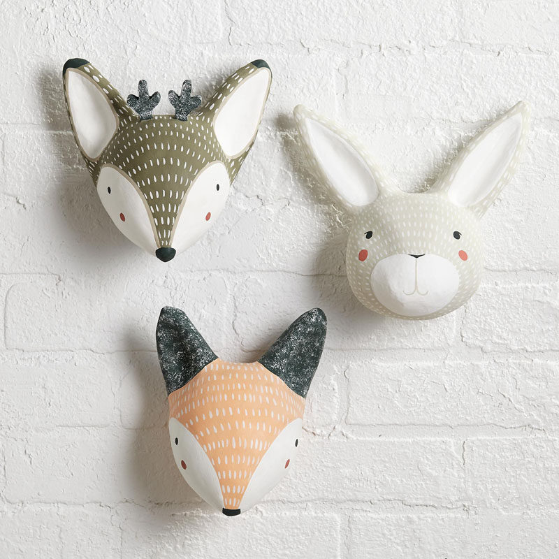 15 Decor Ideas For Creating A Woodland Nursery Design // These mounted animal heads add a whimsical touch to your walls and are neutral enough to match any color scheme. #WoodlandNursery #BabyNursery #NurseryArt #ModernNursery
