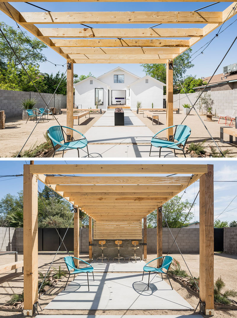 Landscaping Design Ideas - 11 Backyards Designed For Entertaining | This large backyard has tons of seating options, as well as a bar area underneath a pergola to create an ideal entertaining yard.