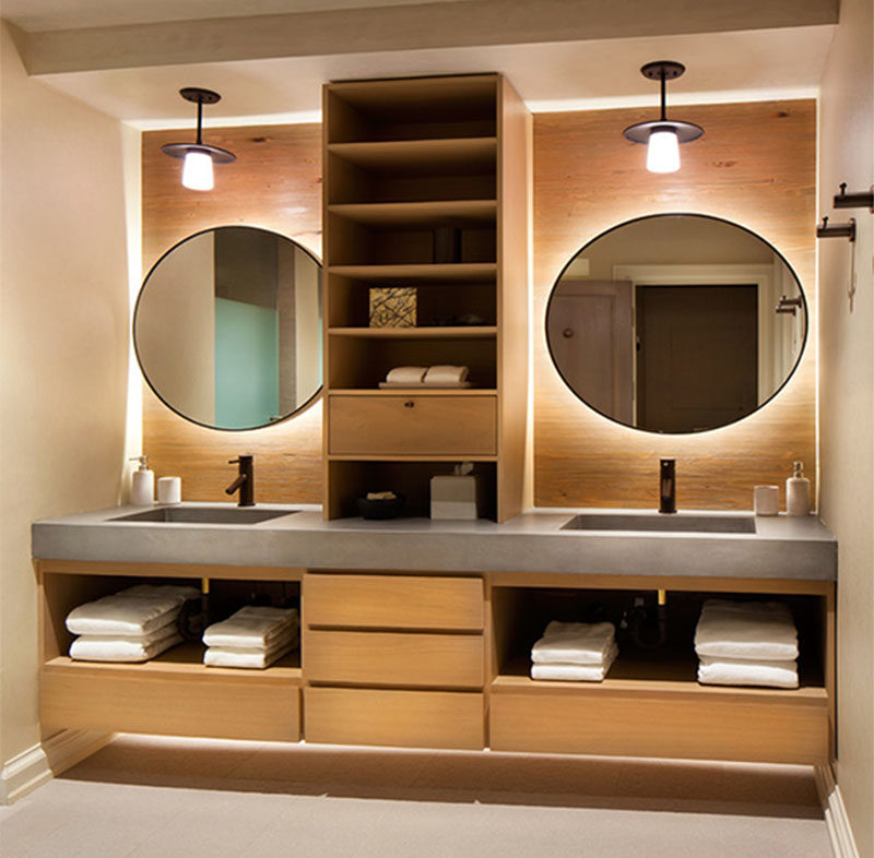 If you're designing a bathroom with double sinks, consider adding wood shelves in between to give each sink its own distinct space.