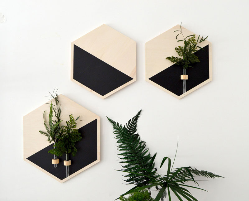 8 Bedroom Wall Decor Ideas // Wall Planters - Bring some life and color to your walls by hanging planters on them. You'll get the benefit of having cleaner air in the bedroom as well as the benefit of having your walls look super stylish.