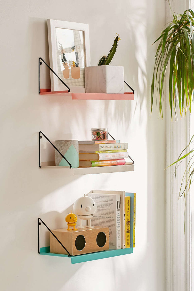 8 Bedroom Wall Decor Ideas // Shelving - Hanging shelves on your bedroom walls gives you the freedom to add even more decor pieces to your walls and lets you get creative in terms of what the shelves look like.