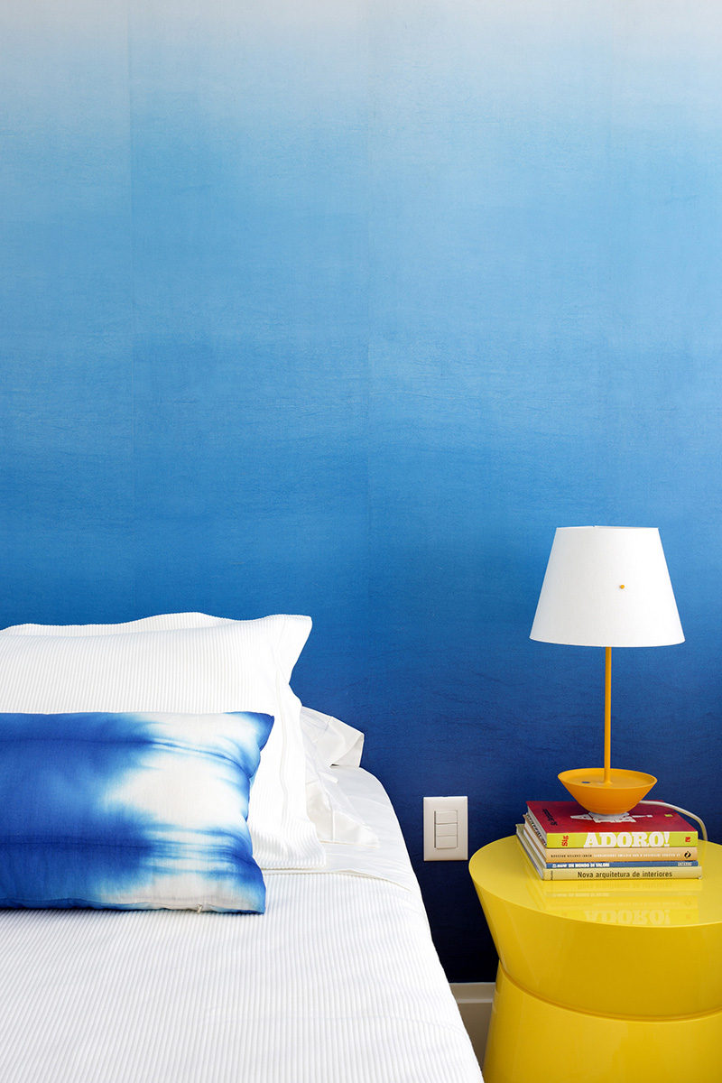 Bedroom Design Ideas - The designers of this apartment used an ombre wallpaper in the bedroom to create an accent wall that's stylish and less overpowering than a full blue wall. #BlueWall #BlueWallpaper #OmbreWall #BedroomDesign #ModernBedroom