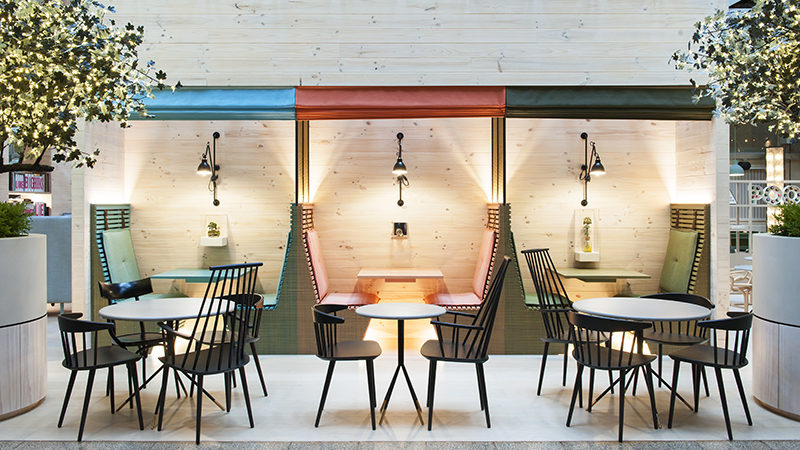 Interior Design Idea – Sometimes, people need a little privacy for a phone call, dinner or discussion when in a public space, especially in a hotel, and one way that can be achieved is by installing drop-down shades. Not only do the shades provide privacy for each booth, they also match the colorful upholstery and furniture within the booth.