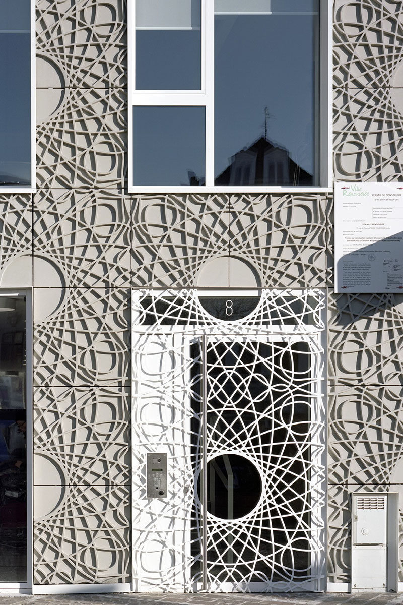 This building facade is made up of decorative concrete panels inspired by a pattern found on bank notes.
