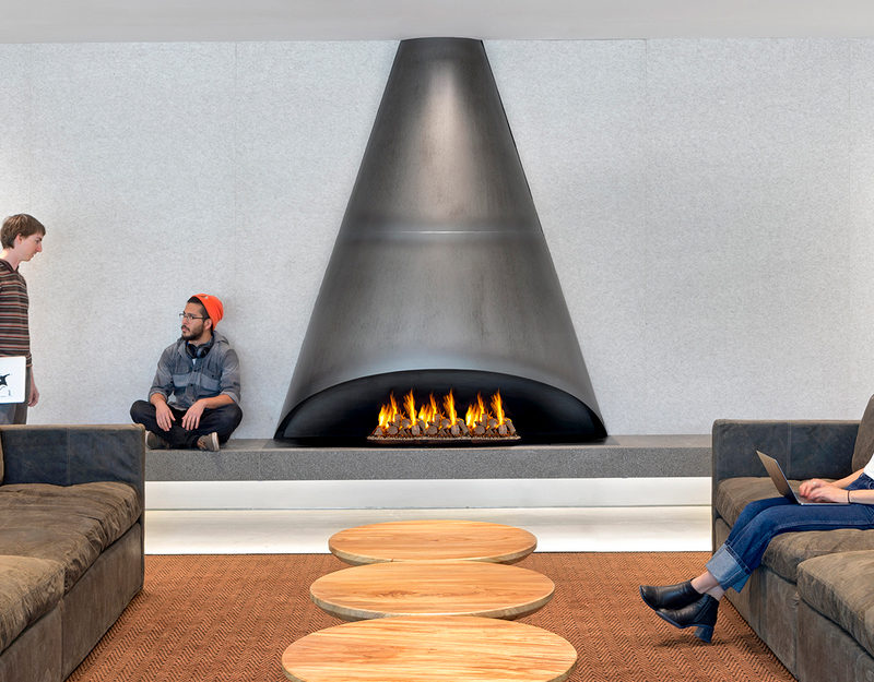 This Cone Shaped Black Steel Fireplace Design Sets A Contemporary Tone For The Room