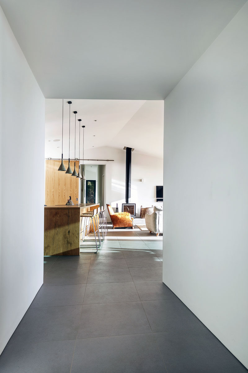 Large dark grey tiles cover the floor of the home and give the interior a cohesive appearance.