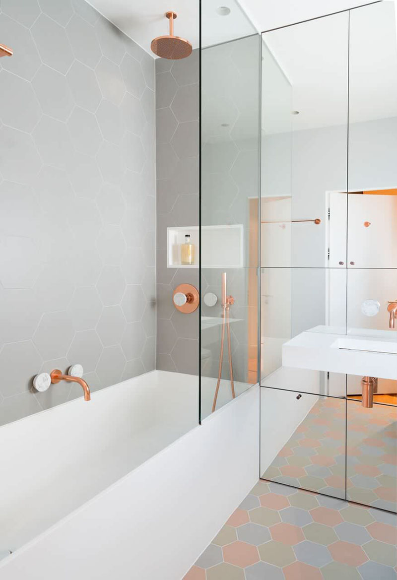 Modern Bathroom Design Ideas - Copper fixtures for the shower and sink with light gray hexagon. «