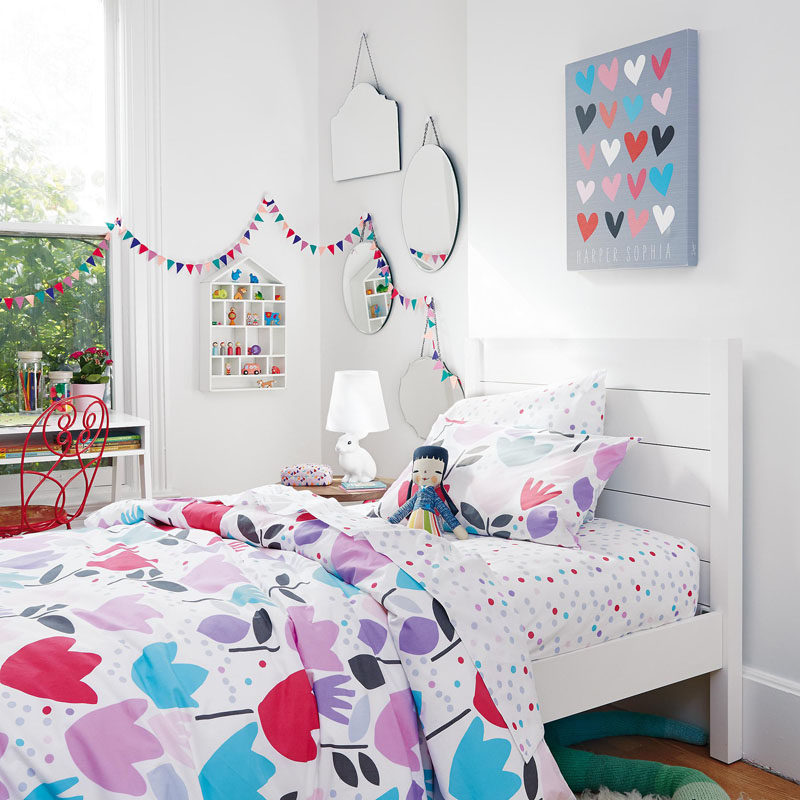 When decorating a bedroom for a little girl, create a fun color palette or purples, greys, pinks and blues.