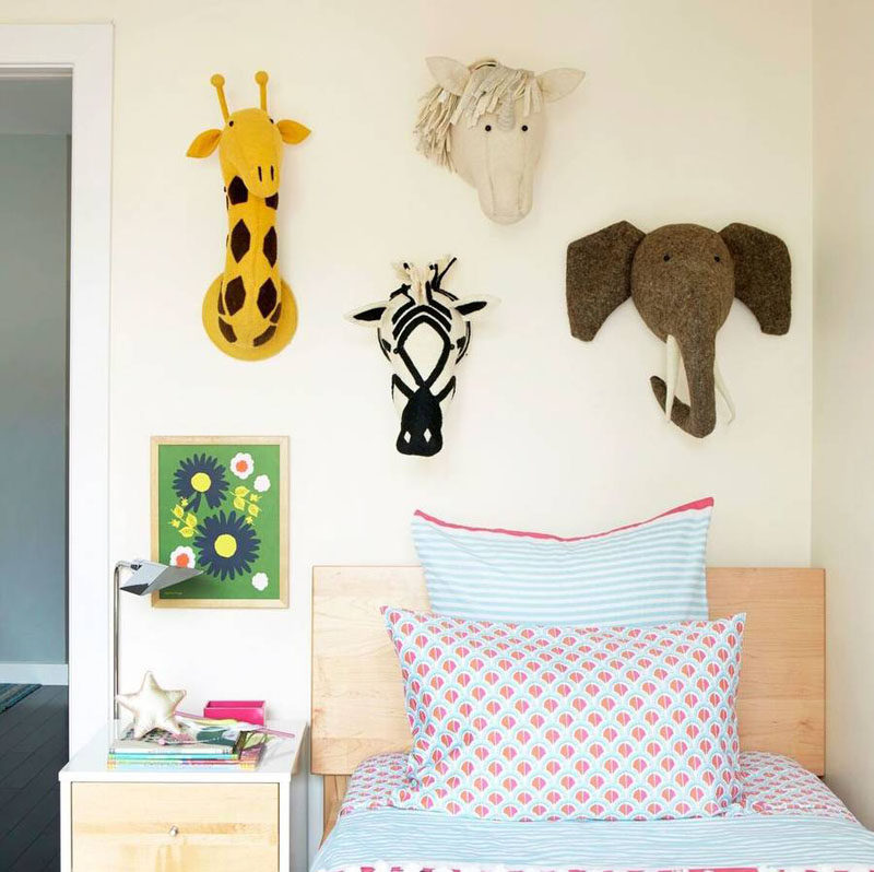 Use fun stuffed animal heads as a cute way to decorate a little girls bedroom.