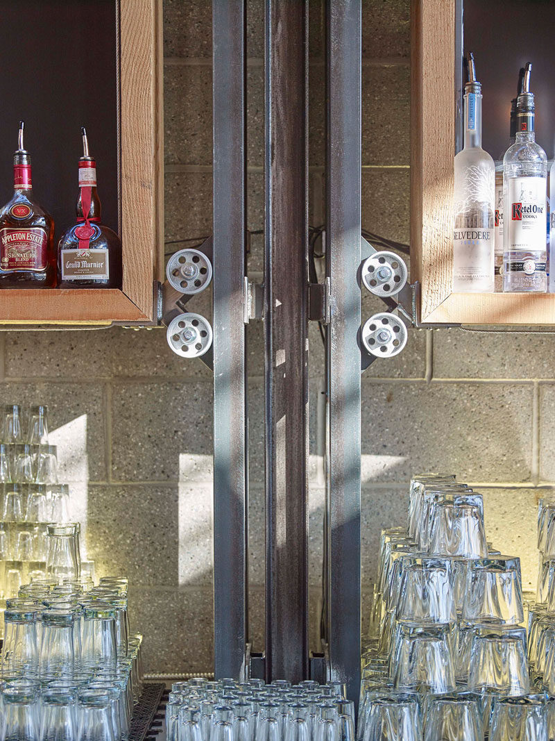 This wheel and pulley system adds an industrial design detail to a brew pub and restaurant.