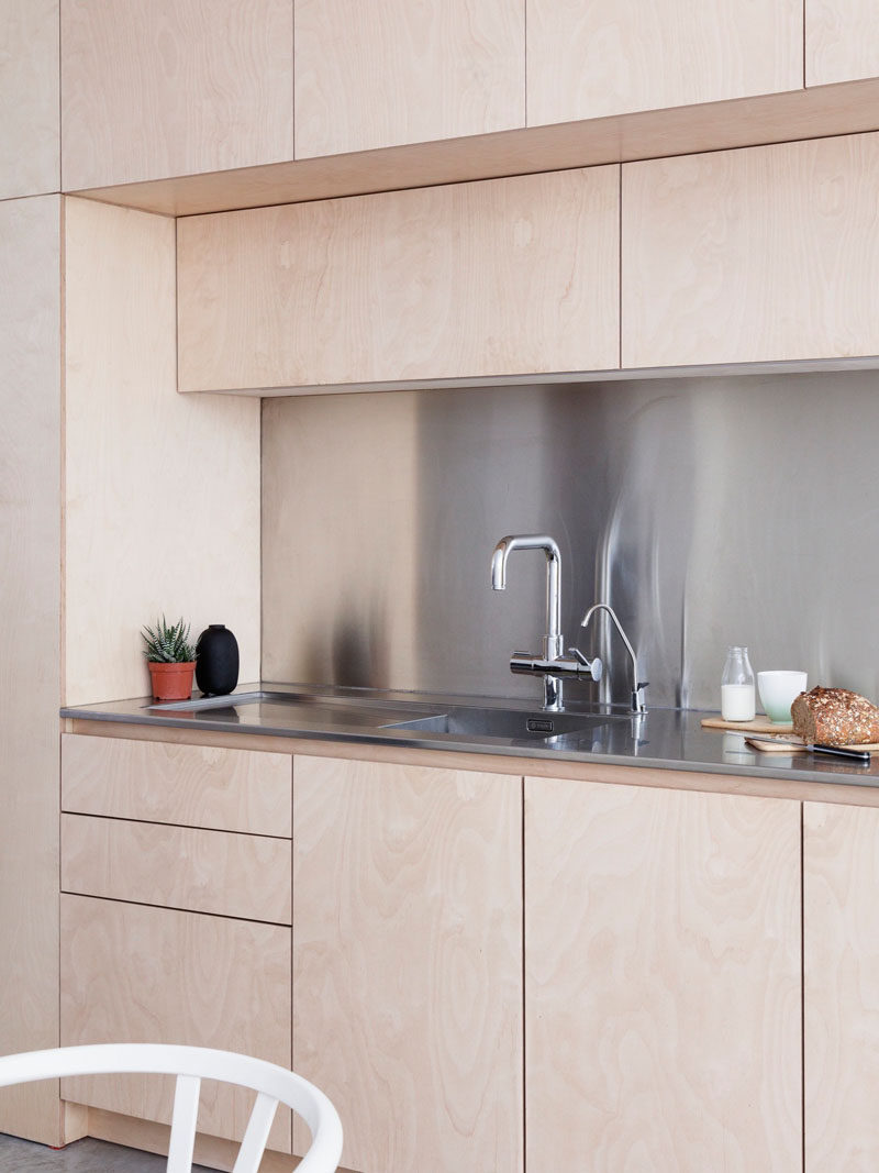 light wood cabinets with stainless steel countertops and