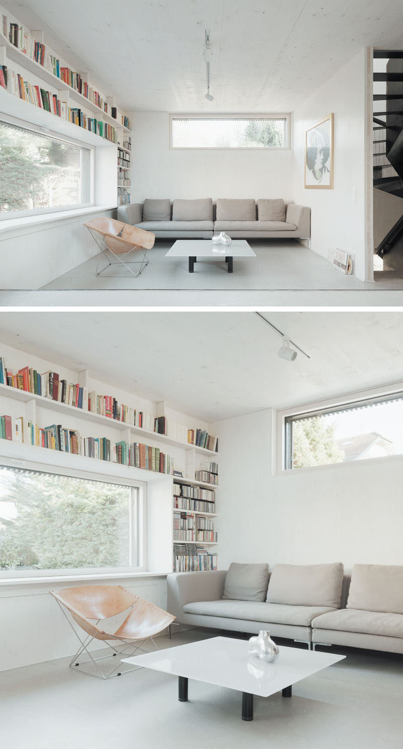 Bookshelves wrap around the window in this small and modern living room.