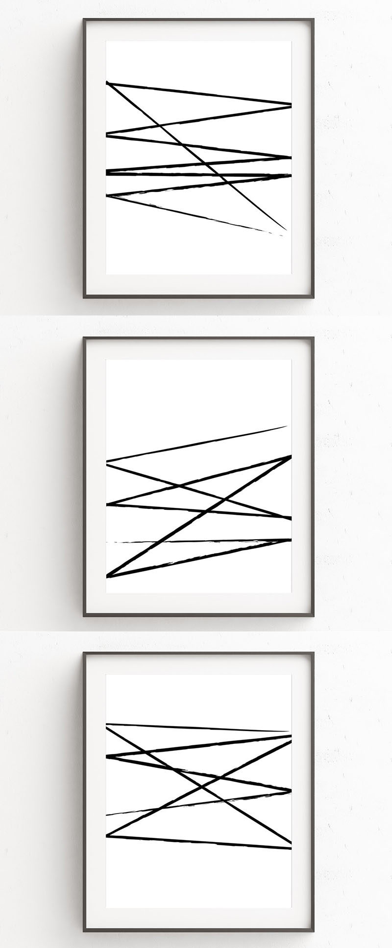 Oju Design has created a series of modern black and white wall art prints that have fierce and imperfect brush strokes slashed across a white background.