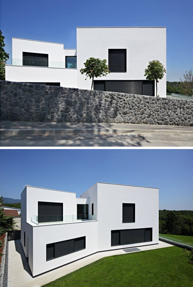 12 Minimalist Modern House Exteriors // The white exterior of this minimalist  home is interrupted
