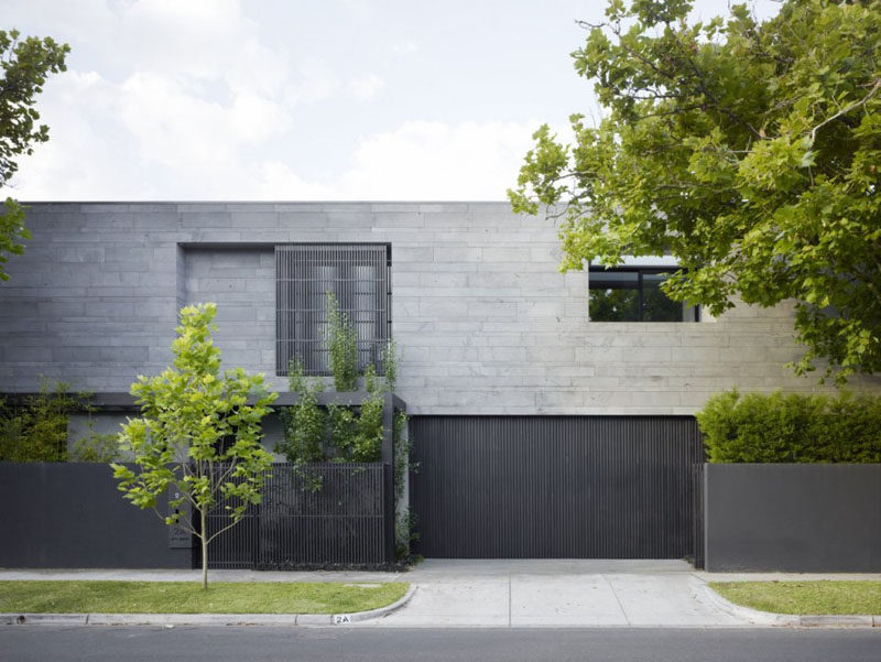 12 Minimalist Modern House Exteriors // Dark materials on the exterior of the house give it a minimalist look and contrast the greenery surrounding it.