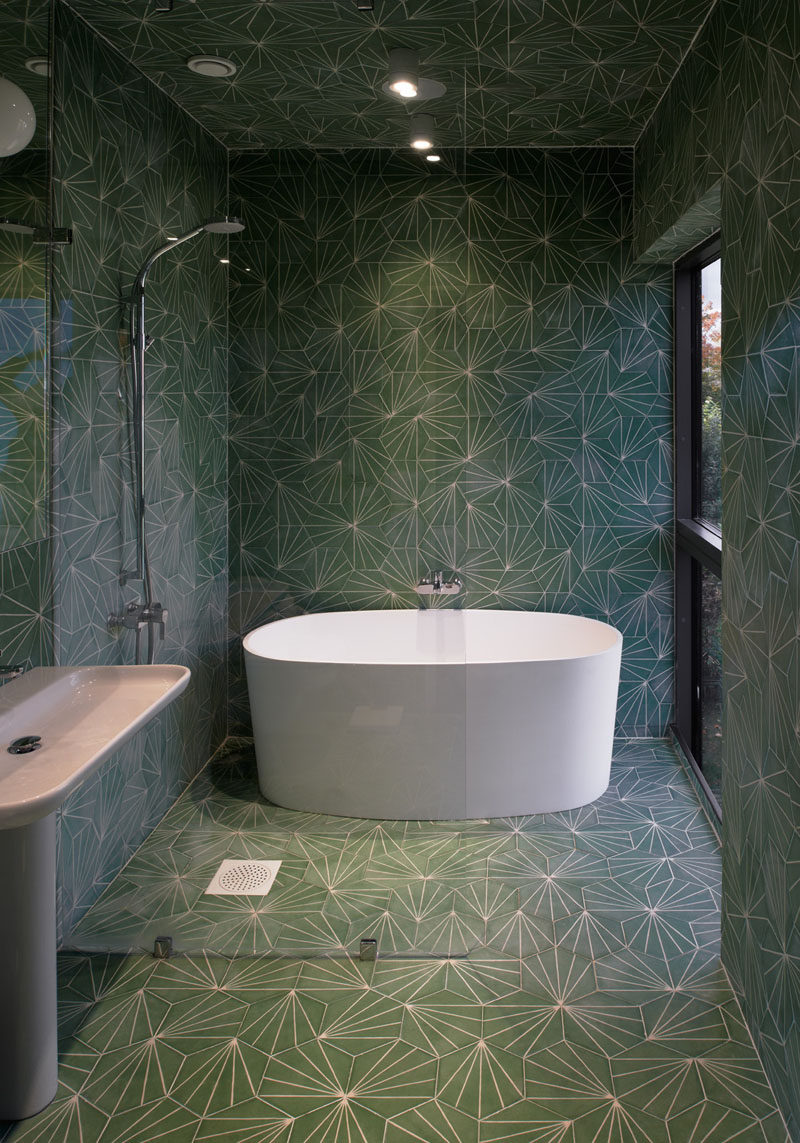 Bathroom Tile Idea - Use The Same Tile On The Floors And The Walls | Not only have the same patterned green tiles been used on the walls and floors of this bathroom, they've also been used on the ceiling!