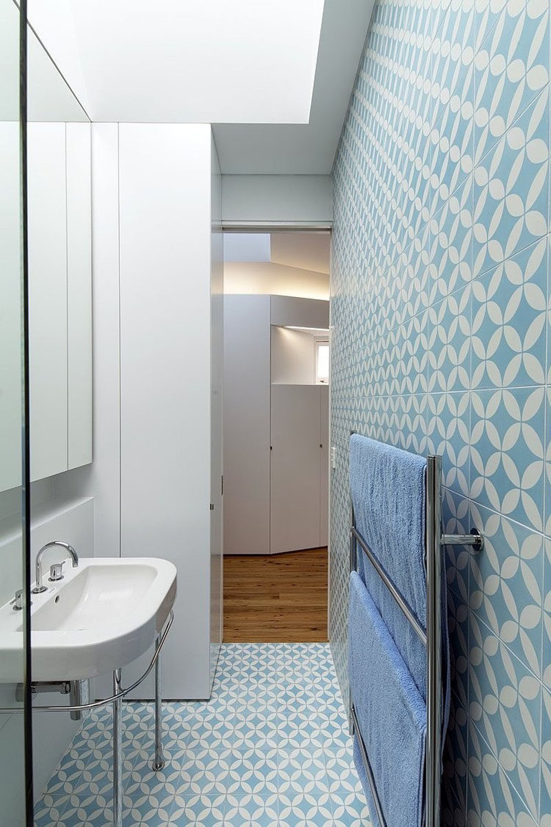 Bathroom Tile Idea - Use The Same Tile On The Floors And The Walls | Blue and white tiles cover the walls and floor of this bathroom to help bring life and color to the space.