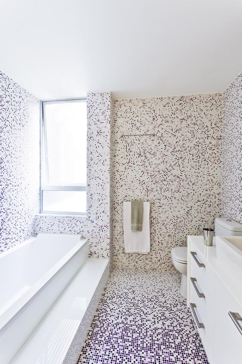 Bathroom Tile Idea - Use The Same Tile On The Floors And The Walls | Tiny purple and white tiles have been placed over the floors and walls of this bright bathroom to create a pixel effect.