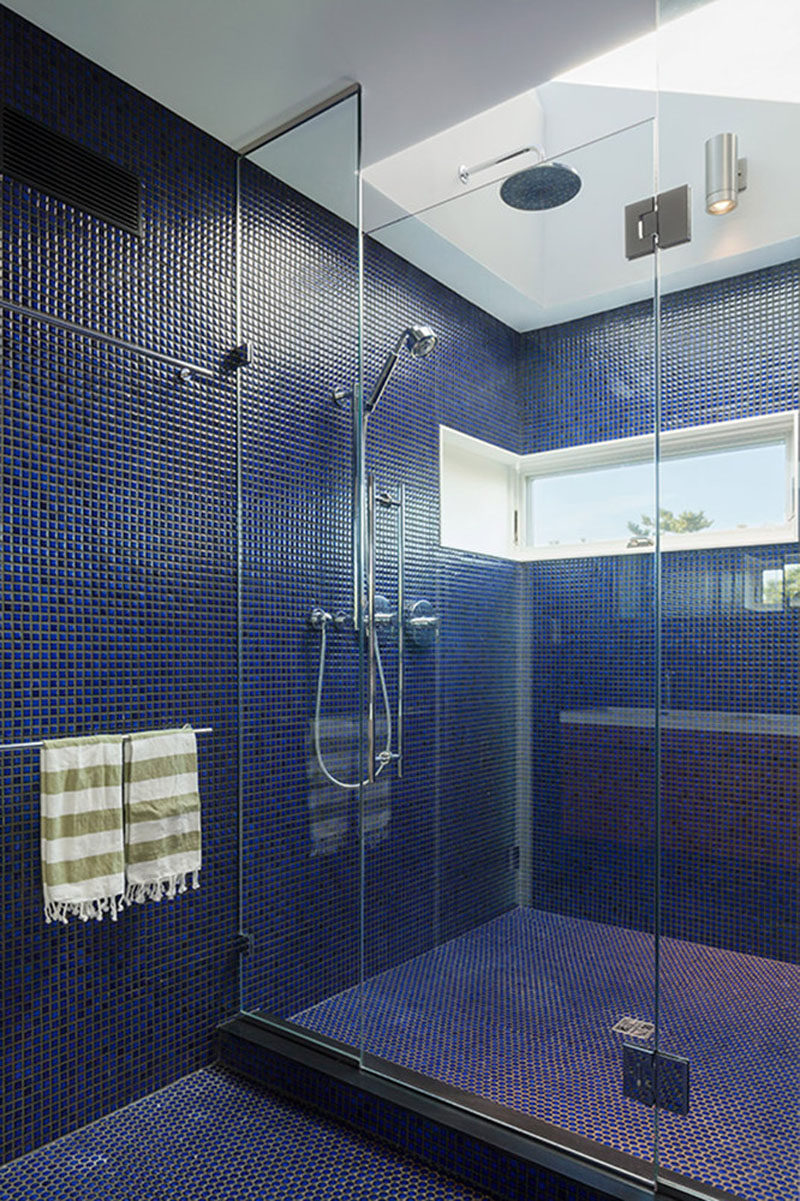Bathroom Tile Idea - Use The Same Tile On The Floors And The Walls | These small blue tiles covering the floor and the walls give the bathroom a textured look and replace the need for colored paint.