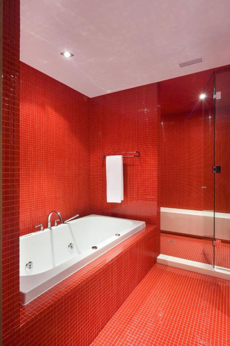 Bathroom Tile Idea - Use The Same Tile On The Floors And The Walls | Bright red square tiles cover the floors and walls of this bathroom making a strong statement when you walk in.
