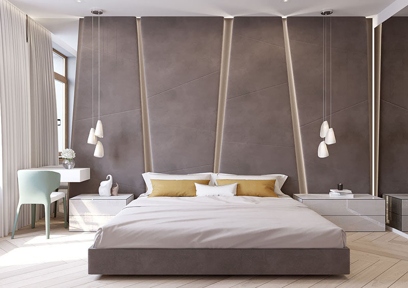 The angular upholstered headboard in this modern bedroom almost ...
