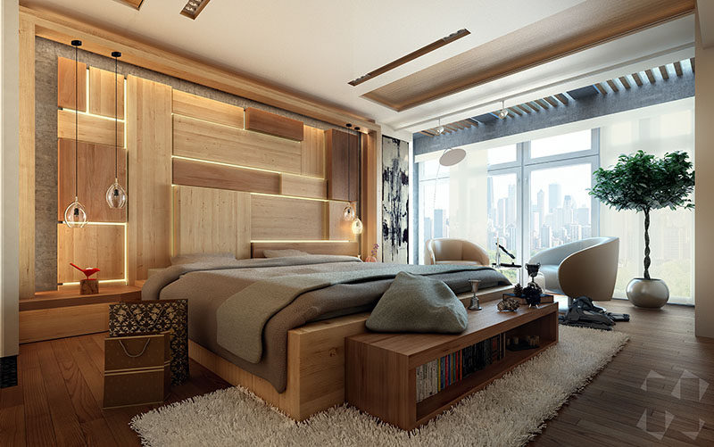 This modern bedroom concept design includes an artistic wood accent wall as a headboard behind the bed, that has hidden lighting to create a soft glow.