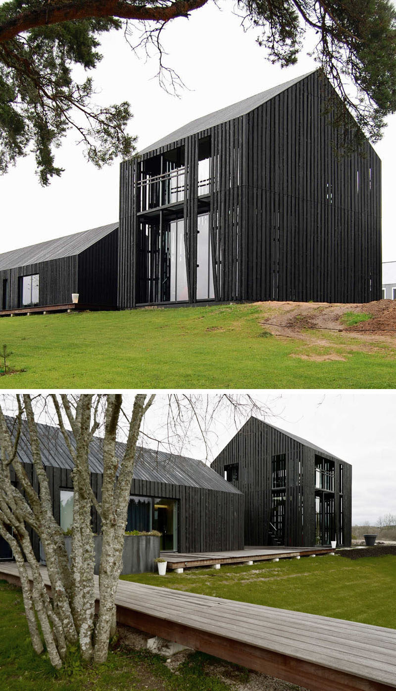 House Exterior Colors – 14 Modern Black Houses From Around The World / Eight black buildings surrounding concrete courtyard make up this family home.