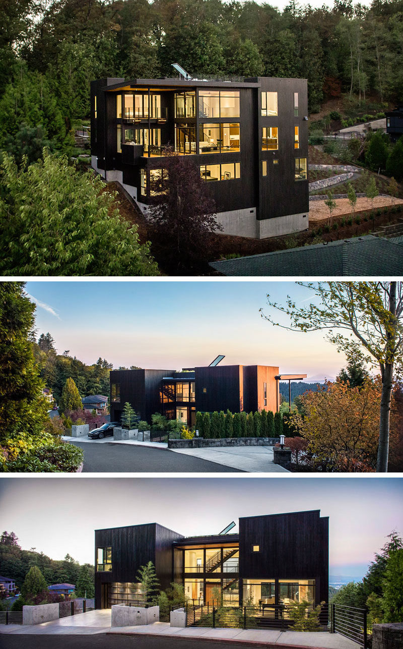 House Exterior Colors – 14 Modern Black Houses From Around The World / This multilevel home is clad in stained black siding that creates a bold statement against the natural greenery of the forest around it.